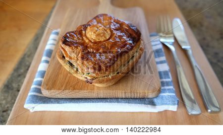 Meat or vegetable savoury pie. Snack photographed in New Zealand NZ.