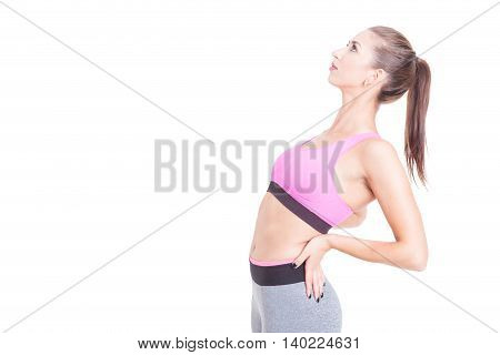 Female Trainer Stretching Her Back Preparing For Workout