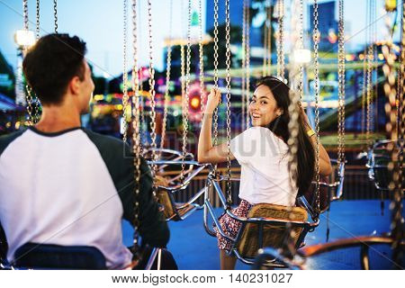 Couple Dating Amusement Park Enjoyment Hugging Concept