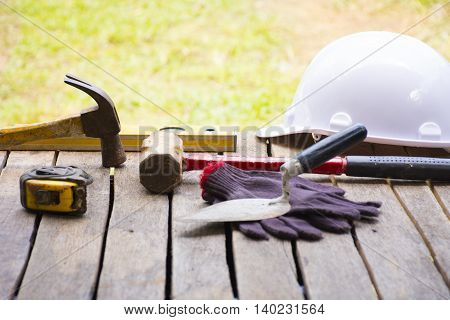 Masonry tool background such as glove and tape measure and sledgehammer with trowel and level with helmet  and etc.Background for craftsman tool or background for building.