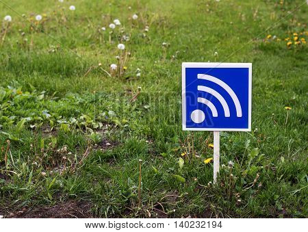 RSS sign on a green lawn. Free wifi simbol