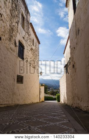 Pedestrian street leading extremely down La Orotava town Tenerife Canary islands Spain