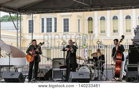 St. Petersburg, Russia - 23 July, The quartet of jazz musicians,  23 July, 2016. Speech by David Goloschekin with his jazz group on the Arts Square in St. Petersburg.