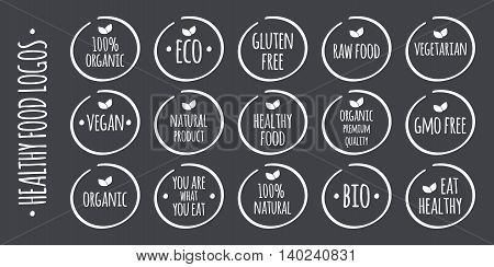 Vector white food logo on grey. 100% Organic Eco Gluten GMO Free Raw Bio Vegetarian Vegan Natural Product Premium Quality You are what you eat Eat Healthy symbols
