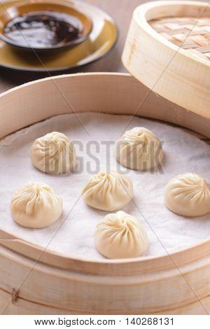 Durian Xiao Long Bao or Chinese dumplings in bamboo tray