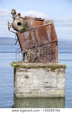 The unidentified rusty object left behind in Columbia River (Astoria Oregon).