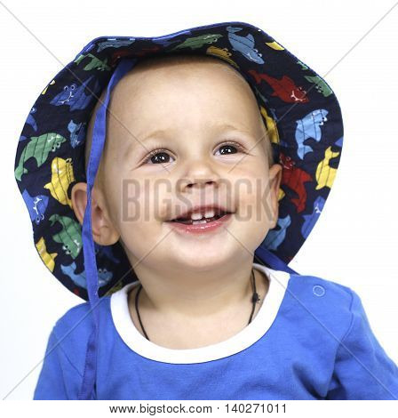 little baby boy cheerfully laughs in sunglasses and hat