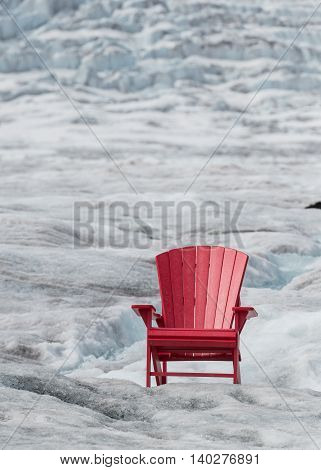 Empty Red Chair with Glacier Ice Background and copy space