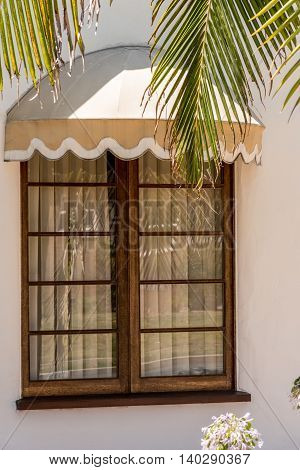 French style window with horizontal panels and vertical venetian blinds covering and with dome marquee awing