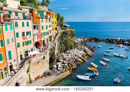RIOMAGGIORE, ITALY - JULY 4: The coastal village of Riomaggiore on July 4, 2016.  Riomaggiore is one of the five villages of the Cinque Terre along the northwestern Italian coast.