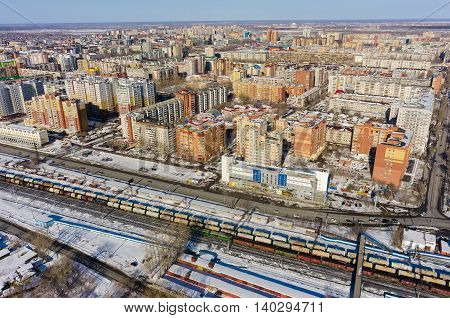 Tyumen, Russia - March 11, 2016: The railroad along 50 let VLKSM Street and residential district