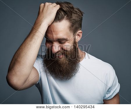 Laughing Bearded Man Holding Hair And Laughing