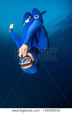Freediver descending with monofin. Free immersion discipline