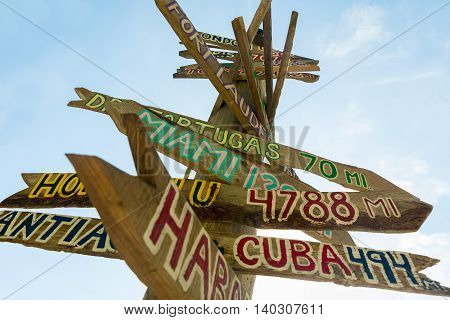 mileage signpost on key west florida beach florida Ancient pointer distances in different directions