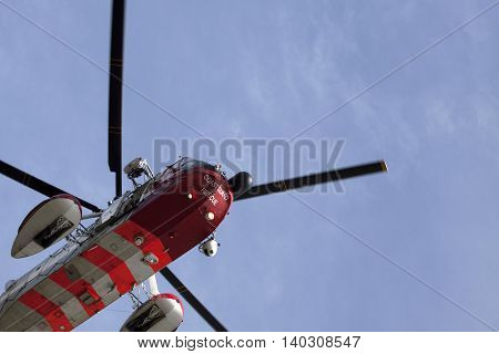 ANDIJIK, THE NETHERLANDS - APRIL 24 ,2013 :Front of a Dutch rescue helicopter flies through the air