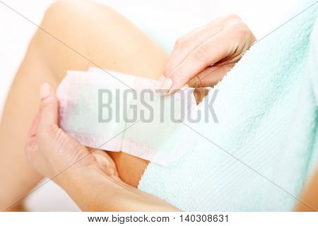 Home waxing. Smooth shaved legs. Hair removal wax. Female depilated legs plaster with wax.