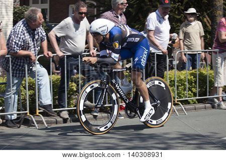Apeldoorn, Holland, May 6, 2016: Cyclist of team quickstep during the prologue of the Giro the italia with spectators along the course