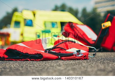 Ambulance car stethoscope and uniform of the doctor emergency medical service - selective focus
