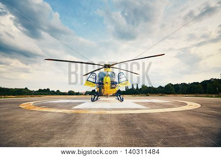 Air rescue service. Helicopter air ambulance is ready for take off at the heliport.