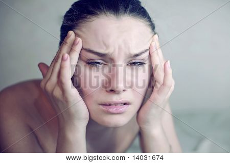 Woman Having A Migraine. Headache Holding Head In Pain