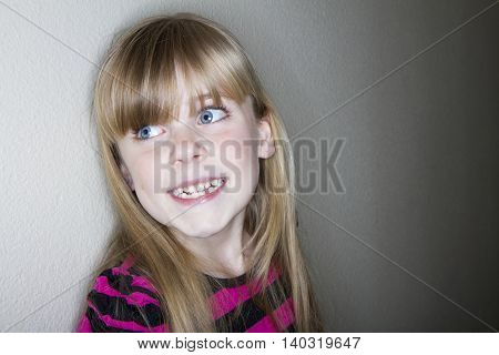 girl gives a nice tooth happy smile