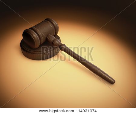 A Judge's gavel being lite in a spotlight with an overall antique fashon