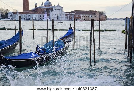 ITALY VENICE - November 20 2013: Two gondolas sit on the dock.