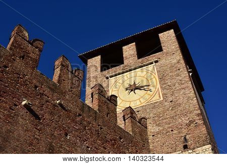 Medieval clock tower from Castlevecchio (Old Castle) outer walls in the center of Verona