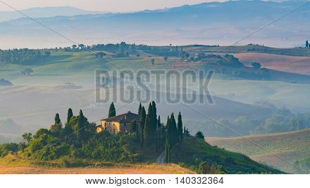 PIENZA, ITALY - JULY 7, 2016: Tuscan villa on a hill in the Tuscany regionnear the village Pienza, Italy