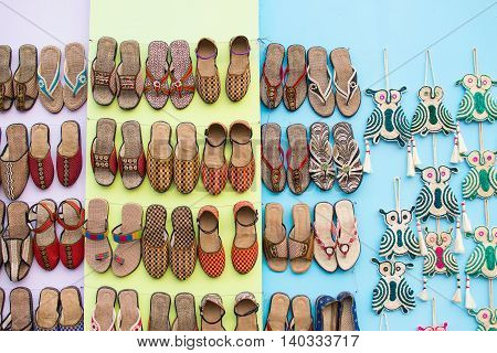 KOLKATA WEST BENGAL INDIA - NOVEMBER 28TH 2015 : Artworks of shoes and handicraft on display during the Handicraft Fair in Kolkata - the biggest handicrafts fair in Asia.