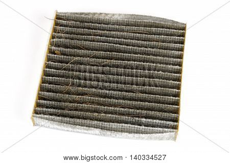dirty cabin air filter isolated on white background
