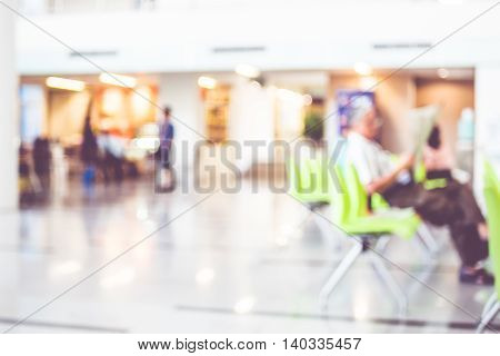 Blur Background : Business Man Reading Newpaper In Building