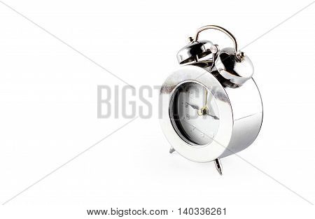 Glossy Sliver Alarm Clock At Grey Background With Reflection On Floor