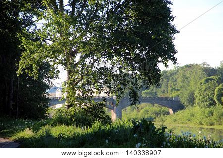 Old historical stone bridge on river. Summer morning. Vologda city, Russia