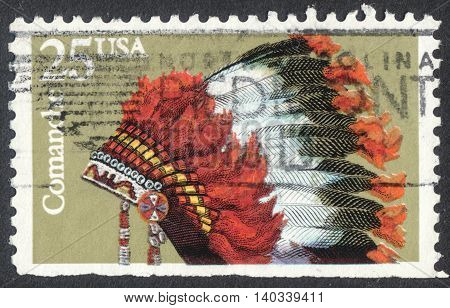MOSCOW RUSSIA - CIRCA APRIL 2016: a post stamp printed in the USA shows an indian headdresses of the tribe Comanche the series