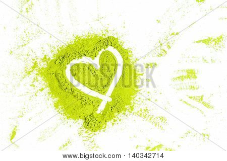 Green Powder Forming Heart Shape Surface Close Up On White Background