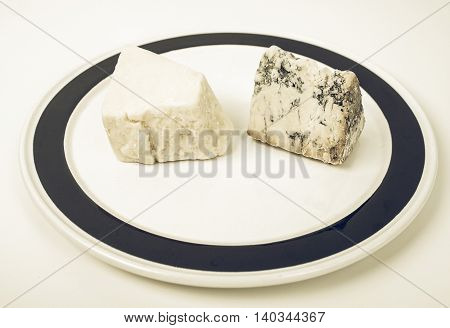 Vintage desaturated Traditional fine British cheeses including Cheddar and Stilton from the English Midlands - in a dish poster