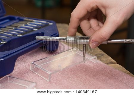 Tappers in acrylic glass in use - closeup tool
