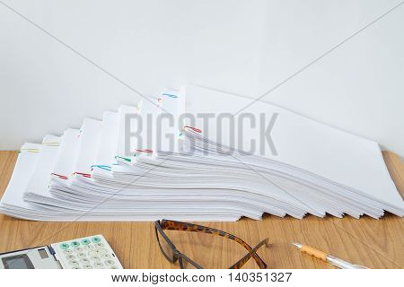 Paperwork With Colorful Paperclip And Calculator Have  Pen And Spectacles