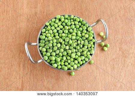 Healthy food pea in a bowl-shaped steel frying pan.