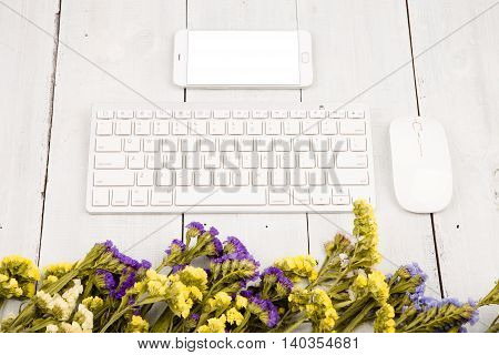 Slim Keyboard, Mouse, Smart Phone, Colorful Flowers On White Wooden Desk