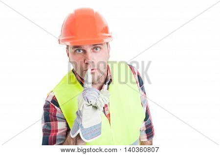 Attractive Builder Doing A Shush Gesture