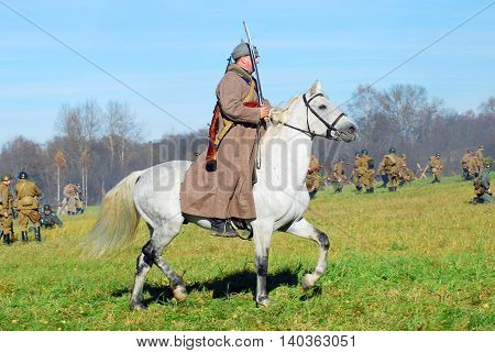 MOSCOW REGION - OCTOBER 13, 2013: Horse rider - reenactor dressed as WW II soldier. The battle he is reenacting was the Moscow Battle held in 1941.