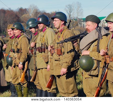 MOSCOW REGION, RUSSIA - OCTOBER 13, 2013: Portrait of a reenactors dressed as WW II soldiers. The battle he is reenacting was the Moscow Battle held in 1941.