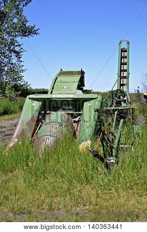 BARNESVILLE, MINNESOTA-June 19, 2016: The old Oliver two row corn picker is from the  Oliver Farm Equipment Company which was purchased by White  Motor Corporation in 1960.
