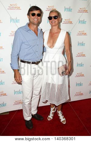 LOS ANGELES - JUL 27:  Grant Show, Katherine LaNasa at the