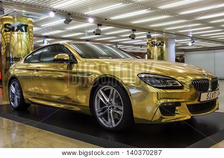 FRANKFURT GERMANY - JULY 24 2016: Golden BMW at the SIXT rental counter in Frankfurt International Airport