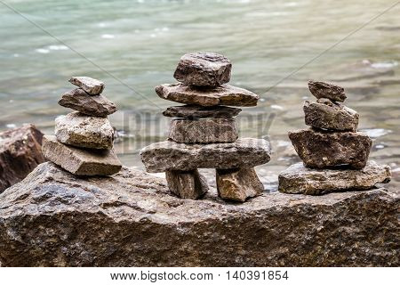 Inukshuk rock piles by the lake in ALberta Canada.