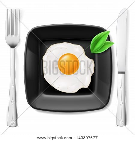 Served breakfast. Fried egg on black plate served with fork and knife