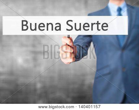 Buena Suerte ( Good Luck In Spanish) - Business Man Showing Sign